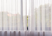White curtain with sunlight in the morning.
