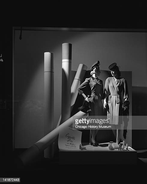 Window Display at Marshall Field Company Display Cigarette Slim new Marlboro inspired silhouette Chicago Illinois August 30 1943