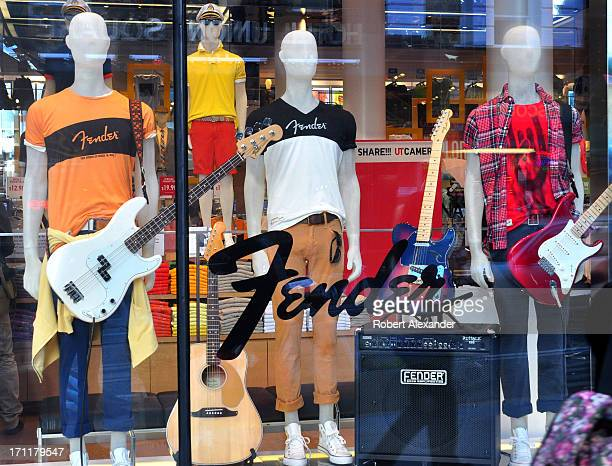 A window display at the Uniqlo store on Powell Street in San Francisco California features a line of Fender brand apparel marketed by a company...