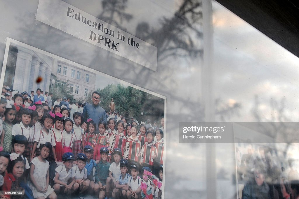 A window display in front of the North Korean embassy shows a photograph of the late North Korean leader Kim Jong-il and the North Korean education facilities on December 19, 2011 in Muri Bei Berne, Berne, Switzerland. Following the death of North Korean leader Kim Jong-il of a heart attack on 17 December, 2011 at the age of 69, his third son Kim Jong-Un is expected to succeed his father. Kim Jong-Un is believed to have studied at the International School of Berne, under a pseudonym, which provides education for 280 students of diplomatic, academic and business families of over 40 nationalities.