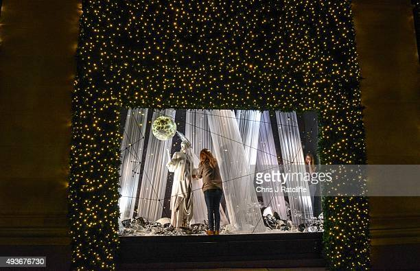 Window dressers put the finishing touches to the Selfridges Christmas display early this morning on October 22 2015 in London England The Oxford...