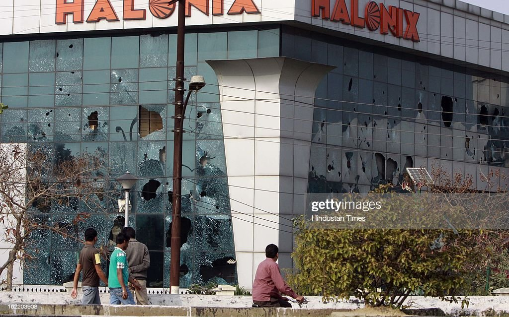 Window glass of factory broken by mob during 48 hours nationwide strike called by eleven major Trade Unions to protest Government's economic and labour policies on February 20, 2013 in Noida, India.