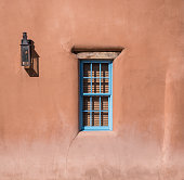 Lantern and window in adobe home in Santa Fe, New Mexico