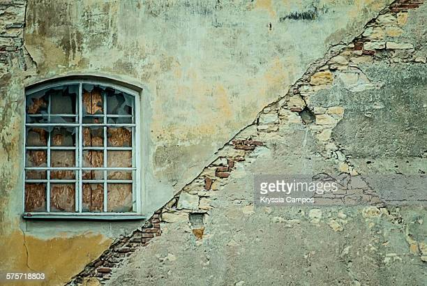 Window in old abandoned brick wall