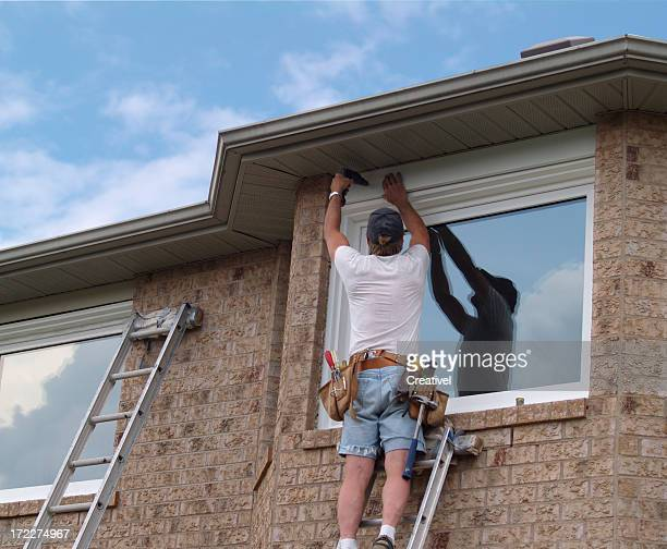 Installing stock photos and pictures getty images for Window replacement contractor