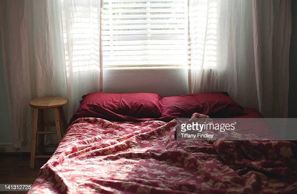 Window light falling on bed