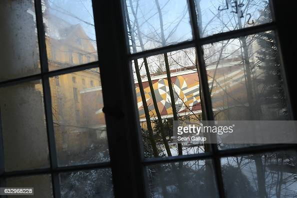 A window look out onto a modern mural decorating an enclosed bridge between the officers' building and an auditorium at the former Soviet military...