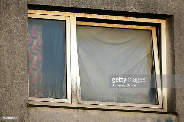 A window of a house where a 73yearold man locked up his daughter in a basement for 24 years and fathered seven children with her seen on April 27...