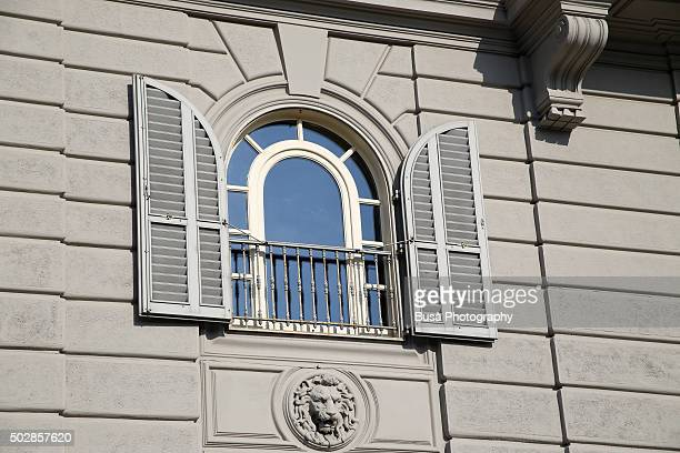 Window of classic residential building on the Lungarno (Arno river banks) area of Florence, Italy
