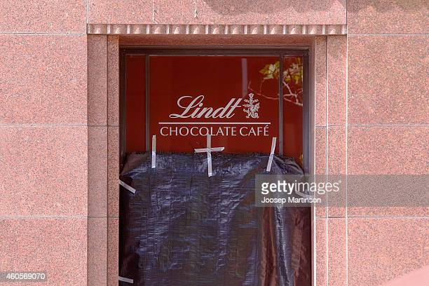 A window of Lindt Cafe in Martin Place is covered with plastic on December 17 2014 in Sydney Australia Sydney siege gunman Man Haron Monis was shot...