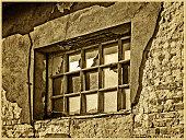 Window of old abandoned workshop - imitation of antique photography.