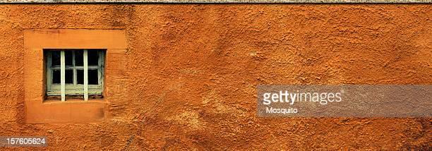 Window on a rusty wall. Panoramic