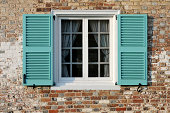 """""""Window on old brick house with shutters, circa 1700's. FOR MORE HOUSES AND DOORS (CLICK"""""""