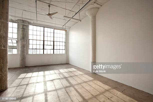 Window shadows in empty loft