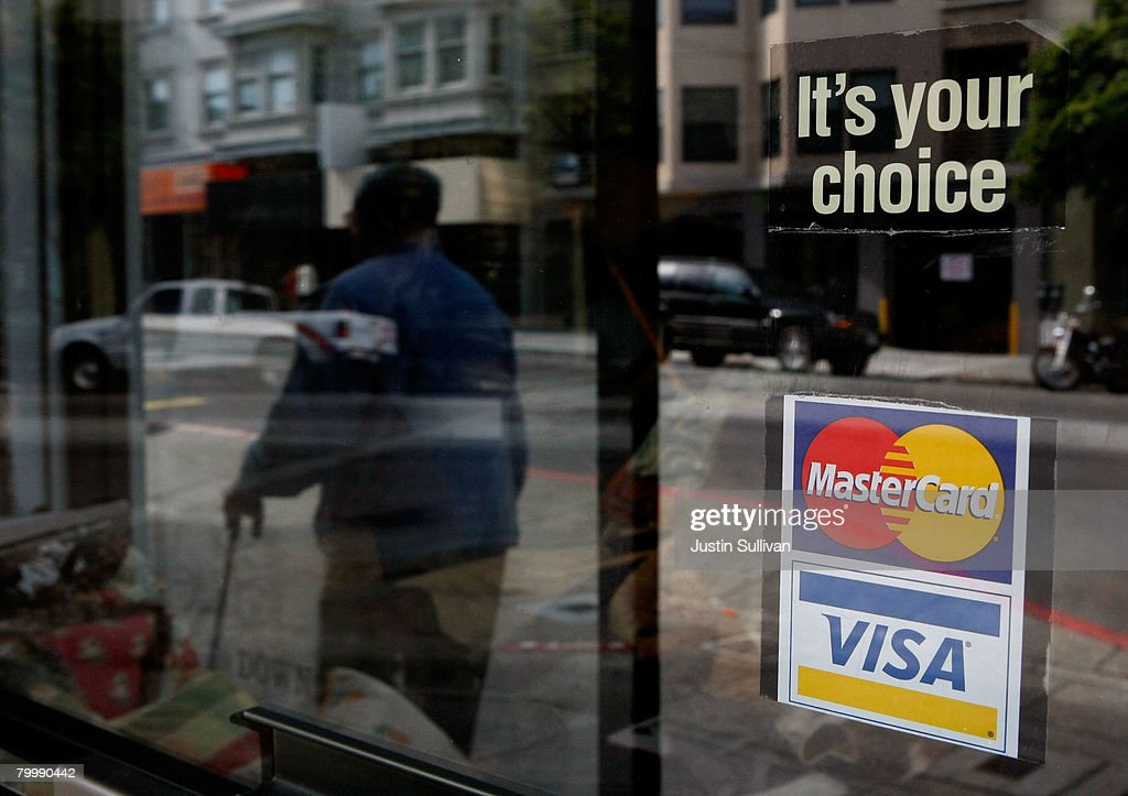 A window sticker advertising Visa and MasterCard credit cards hangs in a window February 25, 2008 in San Francisco, California. Visa Inc. is hoping that its initial public offering could raise up to $19 billion and becoming the largest IPO in U.S. history.
