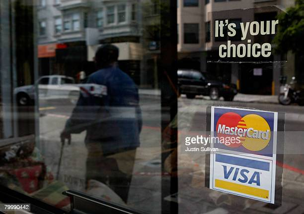 A window sticker advertising Visa and MasterCard credit cards hangs in a window February 25 2008 in San Francisco California Visa Inc is hoping that...