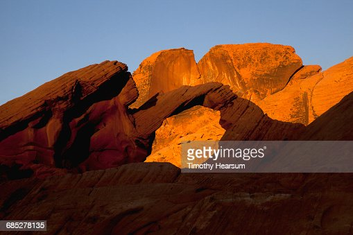 Window through Aztec Sandstone formation at sunset : Stock Photo