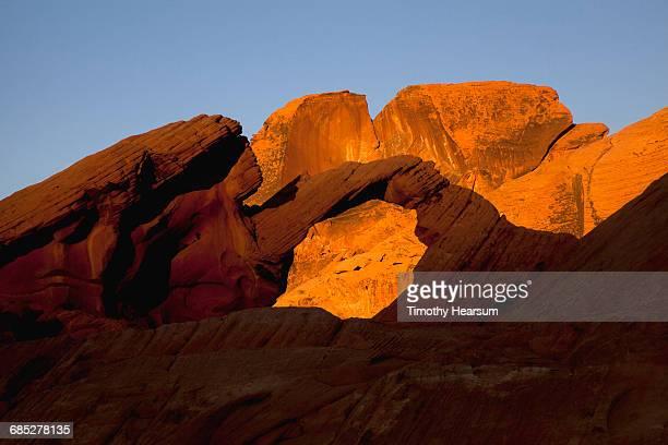 Window through Aztec Sandstone formation at sunset