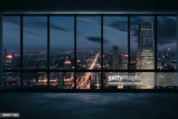 Window View of Illuminated Urban Skyline