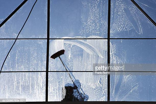 Window washer on glass ceiling