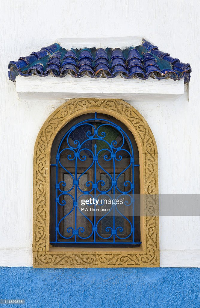 Window with blue wrought iron painted grill, Oudaya Kasbah, Rabat, Morocco : Stock Photo