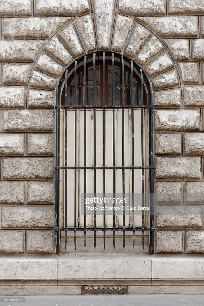 Window with metal grate : Stock Photo