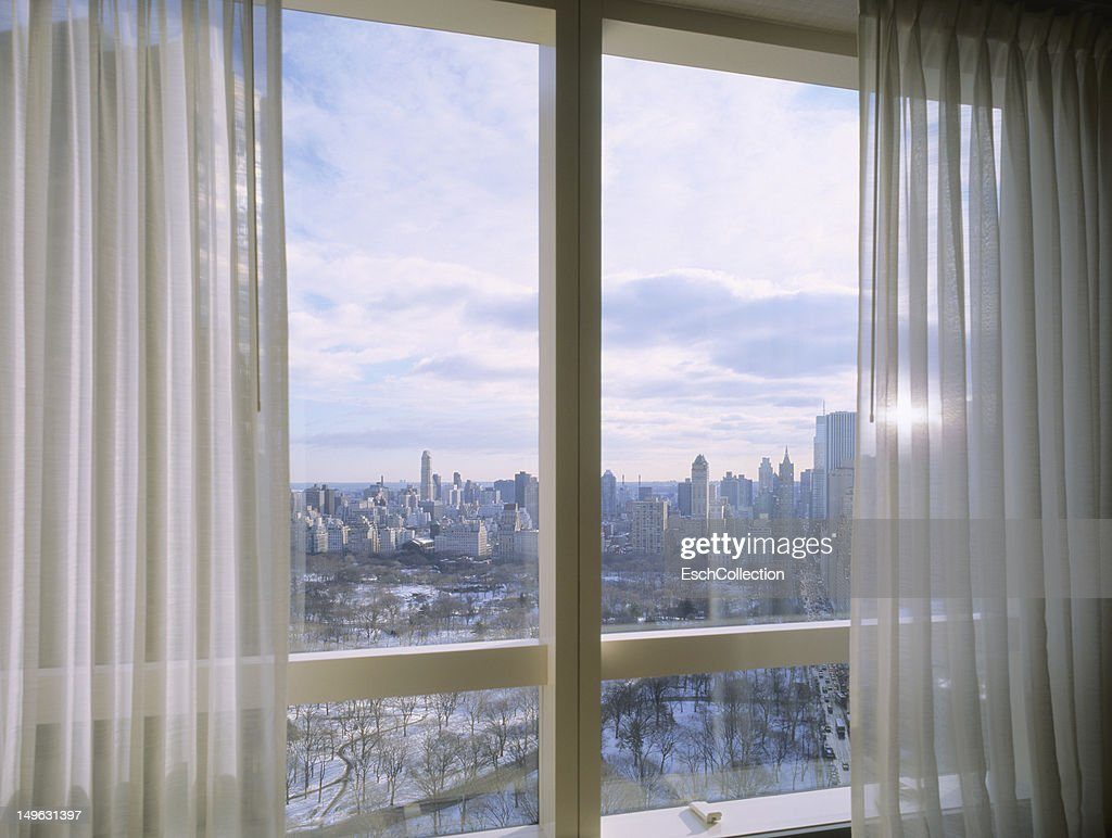 Window with view of a snow covered Central Park : Stock Photo
