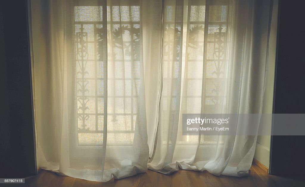 Window With White Curtain