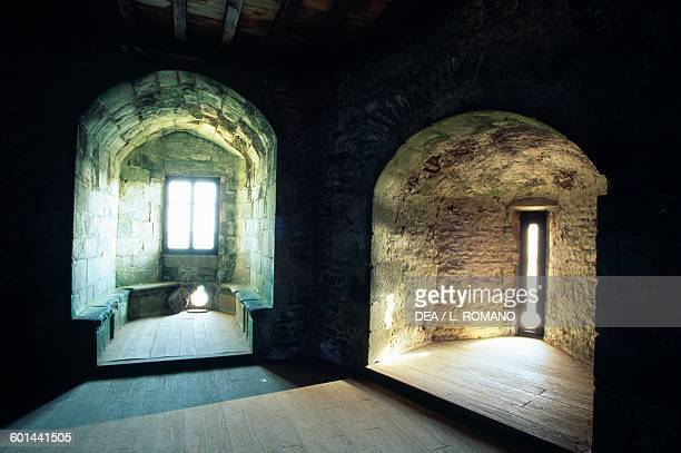 Windows and arrow loops in the dungeon's residential hall FortlaLatte Brittany France 14th18th century