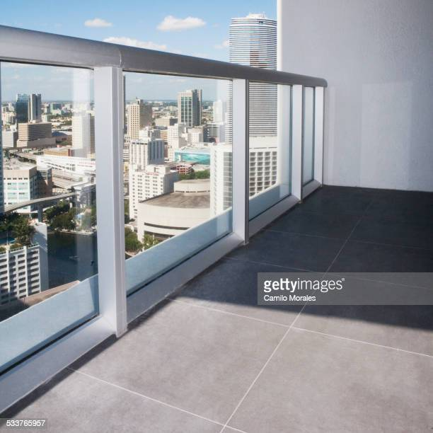 Windows and tile floor in empty apartment