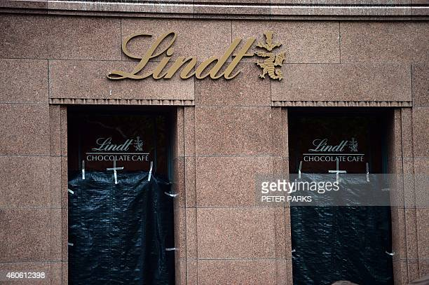 Windows are blacked out at the Lindt cafe the scene of a fatal siege in the heart of Sydney's financial district on December 18 2014 Prime Minister...