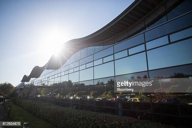 Windows at the Dyson Ltd campus reflect cars parked in the car park in Malmesbury UK on Wednesday Oct 5 2016 In addition to cordless cleaning...