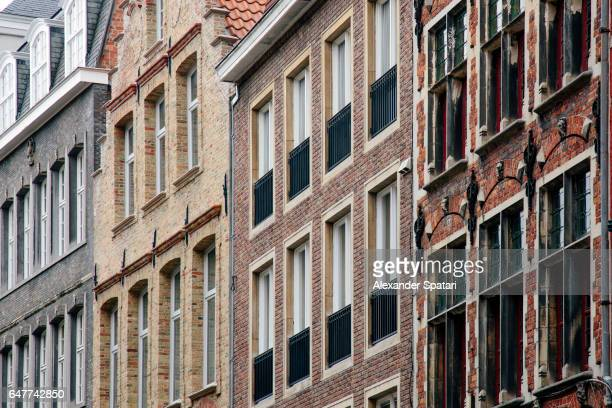 Windows in the traditional Belgian houses in the old town of Bruges, West Flanders, Belgium