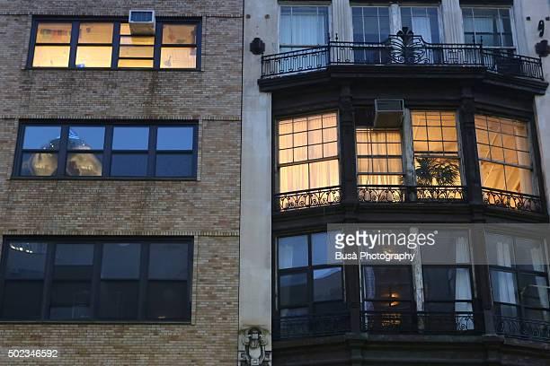 Windows lit up in residential buildings in Manhattan, New York City