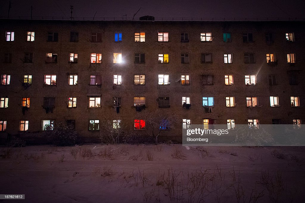 Windows of a Soviet-style apartment block are illuminated in Bishkek, Kyrgyzstan, on Monday, Nov. 19, 2012. Landlocked Kyrgyzstan is the only country in the world that hosts both Russian and U.S. military bases. Photographer: Noriko Hayashi/Bloomberg via Getty Images