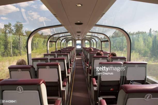 Windows of tour bus in rural landscape