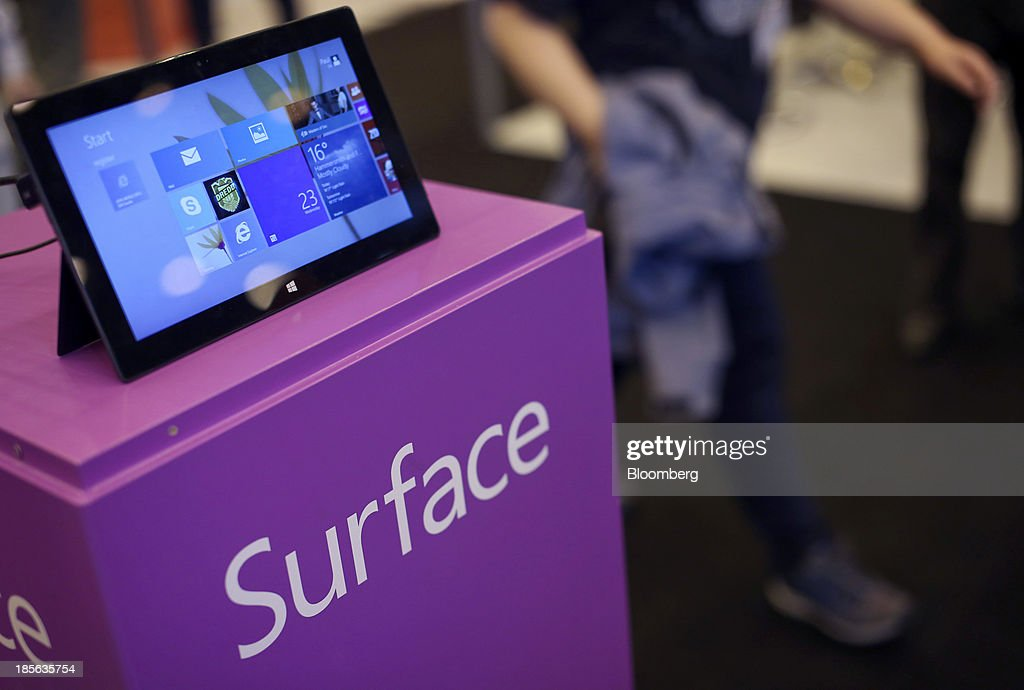 A Windows Surface RT tablet sits on display on the Windows stand during the Apps World Multi-Platform Developer Show in London, U.K., on Wednesday, Oct. 23, 2013. Retail sales of Internet-connected wearable devices, including watches and eyeglasses, will reach $19 billion by 2018, compared with $1.4 billion this year, Juniper Research said in an Oct. 15 report. Photographer: Chris Ratcliffe/Bloomberg via Getty Images
