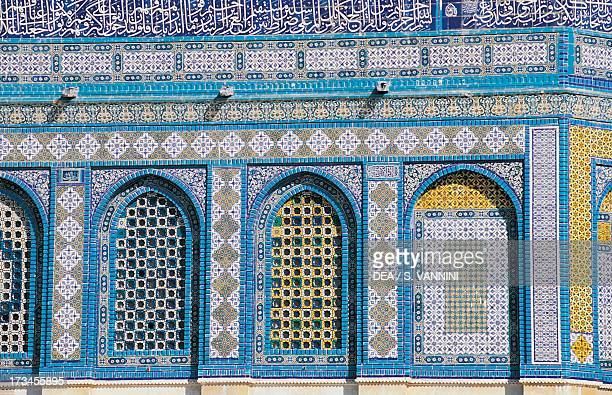 Windows with majolica tile decoration and Koranic verses on the upper section of the wall outer walls of the Dome of the Rock or Masjid AlQubba Old...