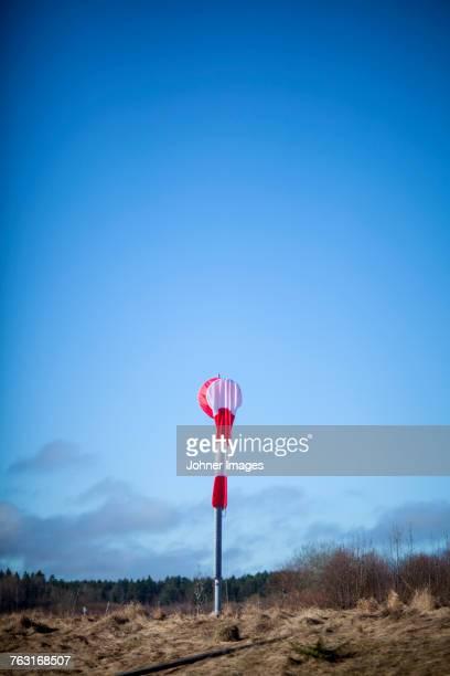 Windsock against blue sky