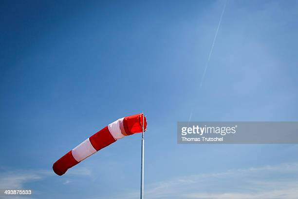 A windsock is blowing in the wind on March 21 2014 in Schoenefeld Germany A windsock can indicate wind direction and relative wind speed