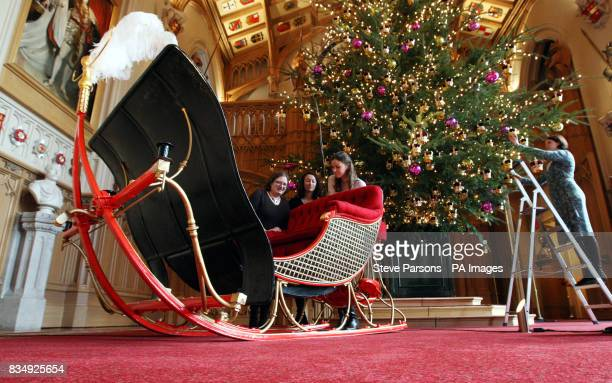 Windsor Castle employees carry out final checks on Queen Victoria's Sleigh which is to go on display for the first in Windsor Berkshire