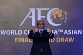Windsor John Asian Football Confederation General Secretary displays a draw for Uzbekistan during the official draw for the final round of the 2018...