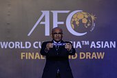 Windsor John Asian Football Confederation General Secretary displays a draw for Thailand during the official draw for the final round of the 2018...