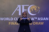 Windsor John Asian Football Confederation General Secretary displays a draw for United Arab Emirates during the official draw for the final round of...