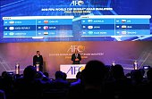 Windsor John Asian Football Confederation General Secretary stands in front of a screen displaying the official draw for the final round of the 2018...