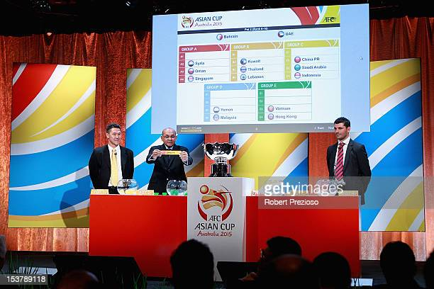 Windsor John Excecutive Director AFC reads out the draw as Alan Davidson former Australian Soccer player and John Aloisi Melbourne Heart ALeague...