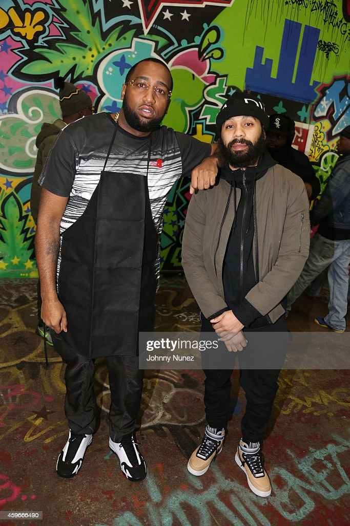 Windsor 'Slow' Lubin and Rodney 'Bucks' Charlemagne attend Slowbucks and Dymes Only 'Help Give Thanks' first annual food drive at the Slowbucks Compound on Thanksgiving day, November 27, 2014, in the Queens borough of New York City.