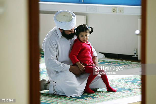 A muslim man and his daughter are pictured during Friday prayers inside a mosque in one of the buildings owned by Medina Dairy near Windsor some 30...