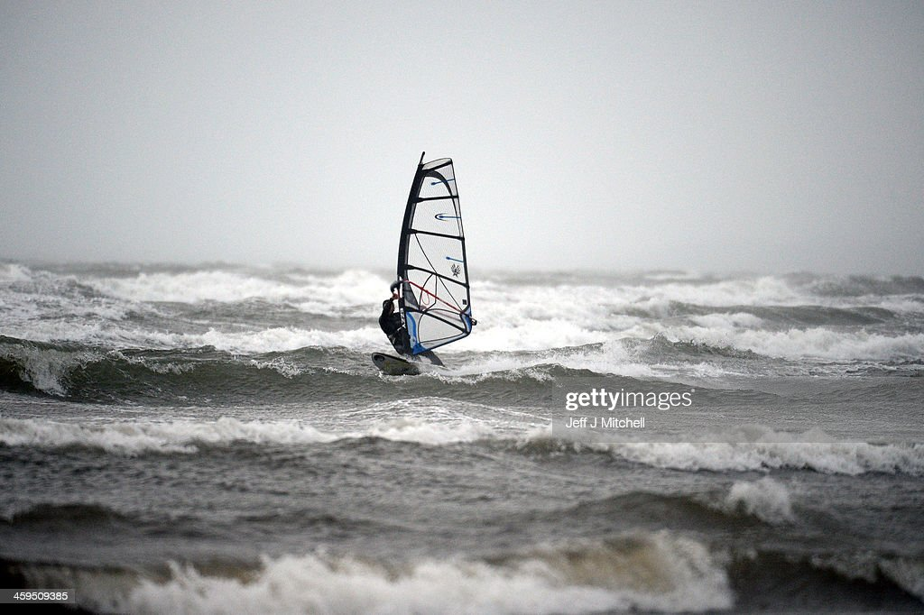 Windsurfer Alan Coutts braves the strong winds at Troon beach on December 27, 2013 in Troon, Scotland. A yellow 'be aware' warning has been issued for many parts of Scotland as the country is affected by gale force winds and heavy rain.
