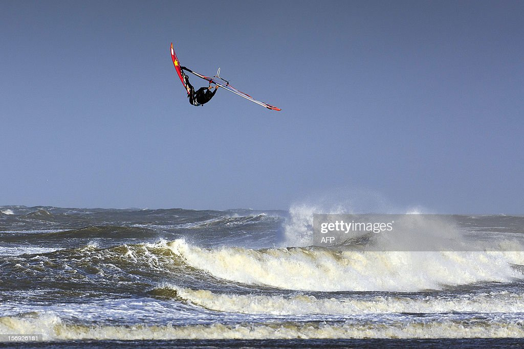 A windsurfer enjoys the waves on the beach at the coastal town of Scheveningen, near The Hague, Netherlands, on November 25, 2012. A storm rages about the Netherlands, especially in the coastal provinces with gusts of wind and wind force nine.